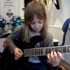 8-Year-Old Girl Shreds on Guitar